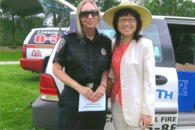 Carol with the Fire Chief Monica at the community event - July 2010